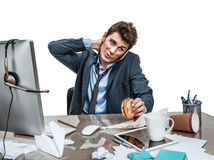 Businessman scratches his head at working place Royalty Free Stock Photo