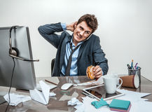 Businessman scratches his head Royalty Free Stock Photo