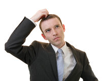 Businessman scratching Royalty Free Stock Image