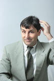 Businessman scratching head Royalty Free Stock Images