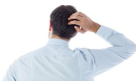 Businessman scratching his head Royalty Free Stock Photos