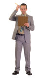 Businessman Scratching His Head. Full body view of a young businessman scratching his head while looking at his clipboard, isolated against a white background Royalty Free Stock Images