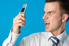 Businessman screaming. Angry businessman screaming on the mobile phone Stock Photography