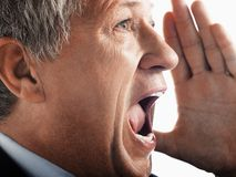Businessman Screaming. Closeup of an angry businessman screaming out loud Stock Image