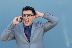Businessman screaming into a cell phone.  Royalty Free Stock Photo