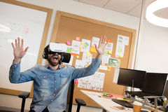 Businessman screaming while experiencing virtual reality. In modern office Stock Photography