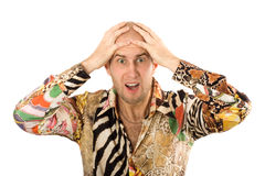 Businessman screaming with hands on head. Isolated over white Stock Photo