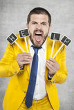 Businessman screaming for help Stock Images