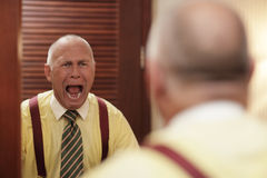Businessman screaming at himself Royalty Free Stock Photo