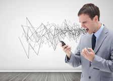 Businessman screaming. And holding his mobile phone Stock Images