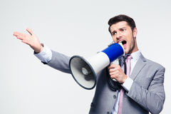Businessman screaming in loudspeaker Royalty Free Stock Photo