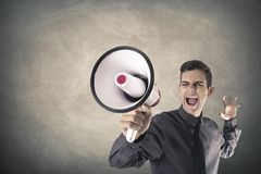 Businessman screaming megaphone. Businessman screaming with the megaphone Stock Photo