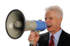 Businessman screaming with a megaphone. Isolated on a white background Royalty Free Stock Photography
