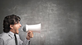 Businessman screaming with a megaphone Royalty Free Stock Photos