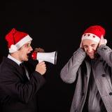 Businessman screaming in megaphone Stock Image