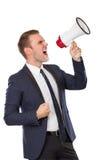 Businessman screaming on megaphone Royalty Free Stock Photos