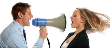 Businessman Screaming into Megaphone at Woman stock image