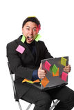 Businessman screaming with notes and laptop Stock Photos