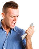 Businessman screaming at the phone. Angry businessman screaming at the phone Stock Photo