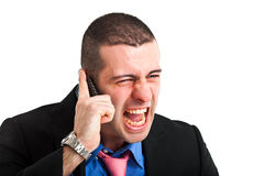 Businessman screaming at the phone. Angry businessman screaming at the phone Royalty Free Stock Photography