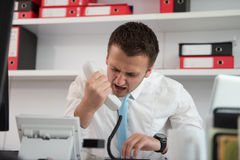 Businessman Screaming Into A Phone Stock Images