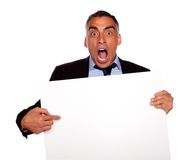 Businessman screaming and pointing a card Stock Photos