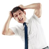 Businessman screaming and pulling his hair. Young caucasian businessman screaming and pulling his hair, isolated on white Stock Photos