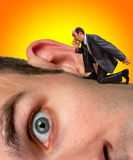 Businessman screaming to ear. Small businessman screaming to big man ear Royalty Free Stock Photography