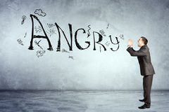 Businessman screaming word angry Royalty Free Stock Photography
