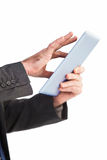 Businessman scrolling on his digital tablet Royalty Free Stock Photos