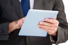 Businessman scrolling on his digital tablet Royalty Free Stock Photo