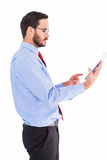 Businessman scrolling on his digital tablet Royalty Free Stock Photography