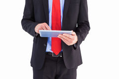 Businessman scrolling on his digital tablet Royalty Free Stock Images