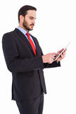 Businessman scrolling on his digital tablet Stock Images