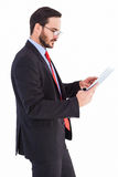 Businessman scrolling on his digital tablet Stock Image