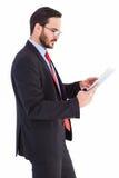 Businessman scrolling on his digital tablet Stock Image