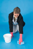 Businessman scrubbing floor Royalty Free Stock Photography