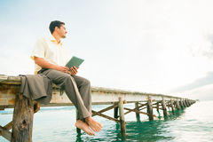 Businessman By The Sea Stock Photo