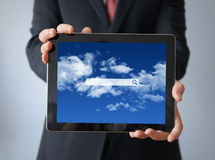 Businessman with search application  on a tablet Royalty Free Stock Photos