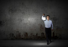 Businessman in search in darkness Stock Image
