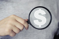 Businessman search loupe magnifier dollar icon Stock Image
