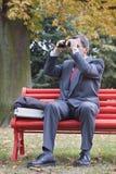 Businessman searching with binoculars Stock Image
