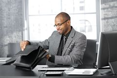 Businessman searching in briefcase Royalty Free Stock Photos