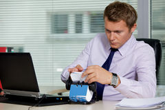 Businessman searching for card by laptop in office Royalty Free Stock Photography