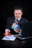 Businessman is searching country on the world Royalty Free Stock Image