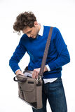 Businessman searching documents in his bag Stock Images