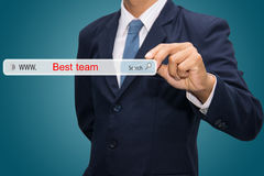 Businessman searching internet for Best TEam Royalty Free Stock Image