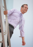 Businessman searching for opportunity. Image of a businessman on a tower looking for business opportunity Stock Photography