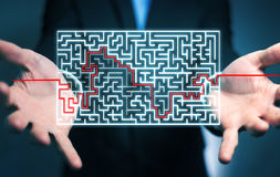 Businessman searching solution of a complicated maze Royalty Free Stock Photo