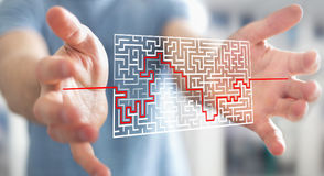 Businessman searching solution of a complicated maze Stock Photo